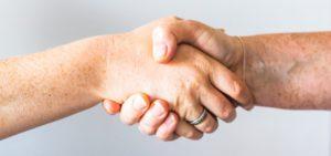 shaking hands, image for mentoring mentors